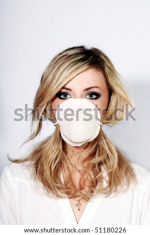 Young beautiful nurse in mask