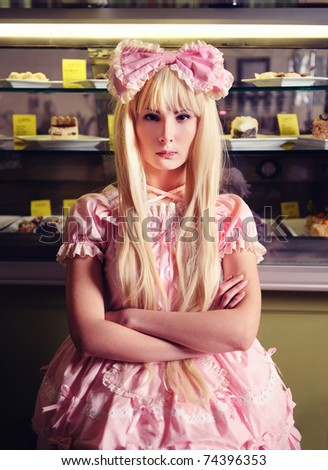 Young beautiful offended woman with a cakes. - stock photo