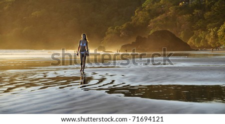 Young beautiful on a beach. One. Coast Pacific of ocean in Costa Rica. - stock photo