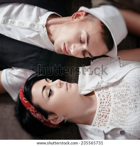 young beautiful pair of hipsters are love look in face on bed - stock photo