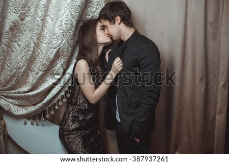 Young beautiful pair of lovers hug and kiss