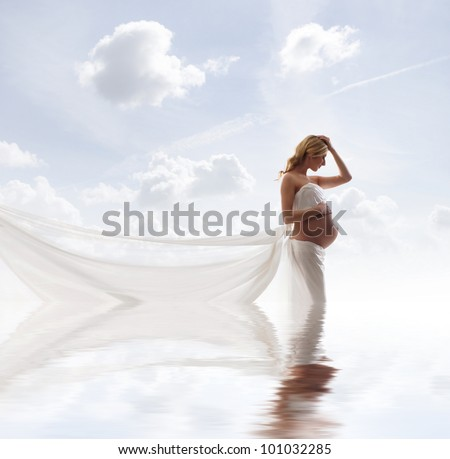 Young beautiful pregnant woman over sky background - stock photo
