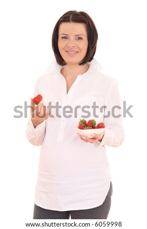 young beautiful pregnant woman with fresh strawberries isolated on white