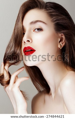 Young beautiful pretty woman with healthy brown hair. In studio.  - stock photo