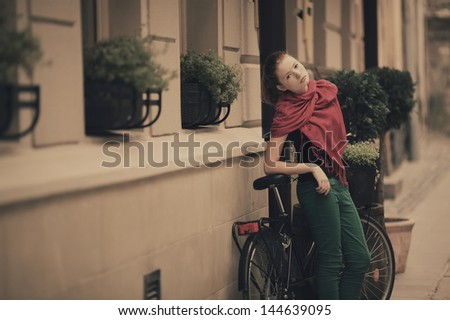young beautiful red haired girl urban portrait - stock photo