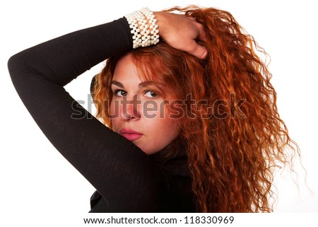 Young beautiful red-haired woman in black dress. Isolated on white background