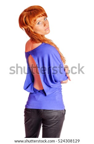 Young beautiful redhead woman turning back isolated on white