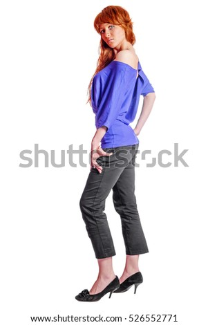 Young beautiful redhead woman wearing blue blouse standing isolated on white