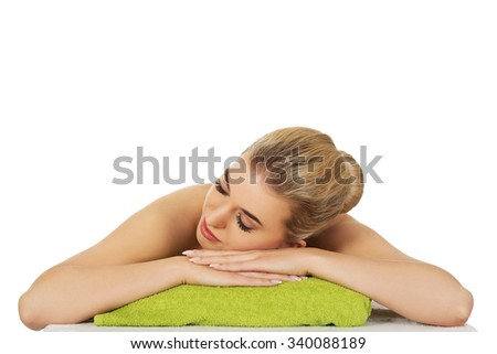 Young beautiful relaxed woman in spa. - stock photo