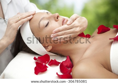 Young beautiful relaxing woman having a facial massage. Please, view my other pictures of this series below: - stock photo