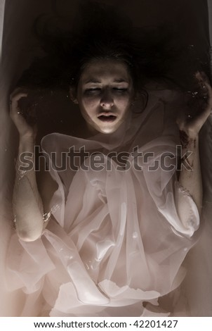 Young beautiful sad girl suicide in bathroom - stock photo