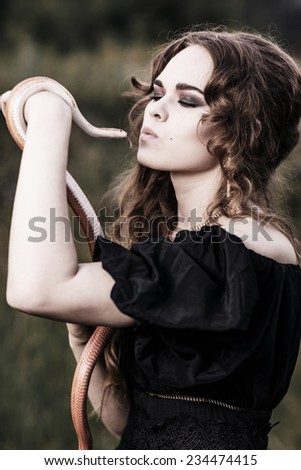 Young, beautiful, sensual woman with snake - stock photo