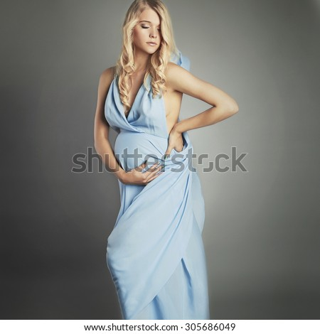 Young beautiful sexy and stylish pregnant woman.fashion portrait of Blonde bride in wedding dress - stock photo
