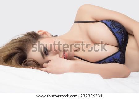 Young beautiful Sexy Asian model wearing elegant lingerie - in studio - stock photo