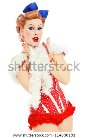 Young beautiful sexy happy excited pin-up girl in red corset, over white background - stock photo