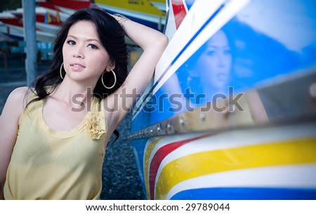 Young beautiful sexy Model Posing beside the boat