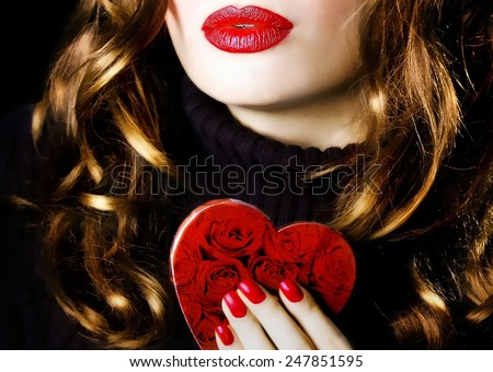 Young beautiful sexy pretty woman holding a red heart makeup valentine love romance - stock photo