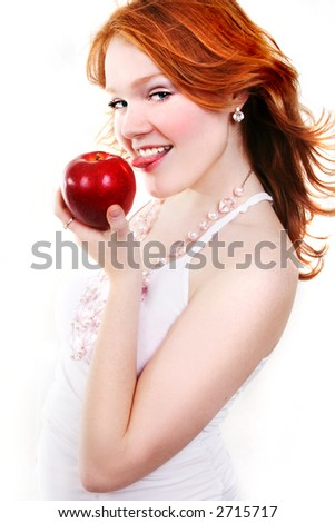 young beautiful sexy red eating apple woman on the white background