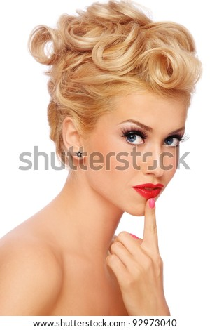 Young beautiful sexy stylish blond girl with thoughtful expression, on white background - stock photo