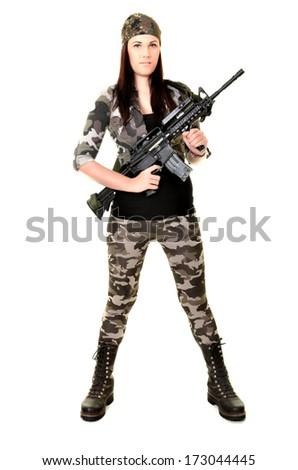 Young beautiful sexy Woman holding Handgun in hand  - stock photo