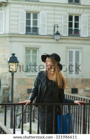 Young beautiful sexy woman in a hat in Paris - stock photo