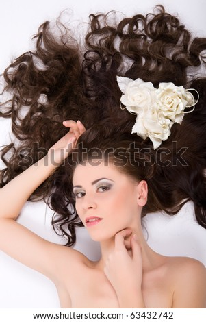 Young beautiful sexy woman with flowers roses