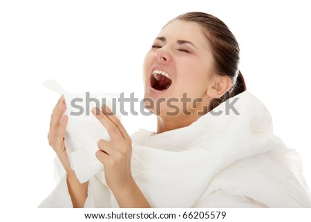 Young beautiful sick woman sneezeing ,isolated on white background - stock photo