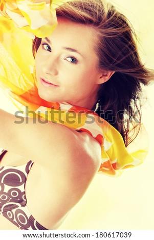 Young beautiful slim woman posing in bikini - with wind - stock photo