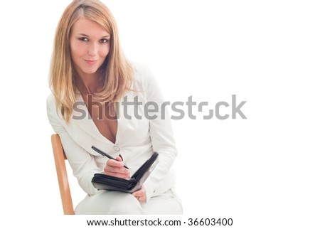 Young beautiful smiling businesswoman making plans, isolated over white