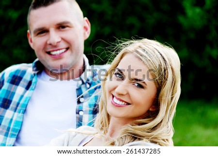 Young beautiful smiling couple in a relationship - stock photo