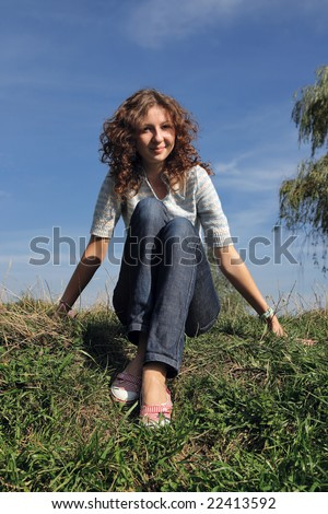 Young beautiful smiling girl for successful advertising - stock photo