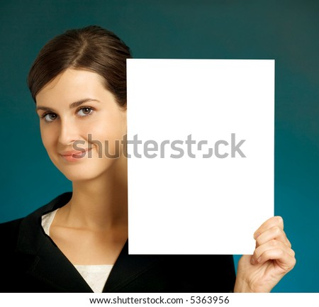 Young beautiful smiling student, secretary or businesswoman with blank - stock photo