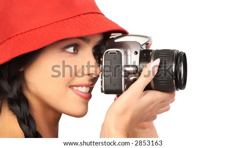 Young beautiful smiling woman holding a photo camera. Isolated over white background - stock photo