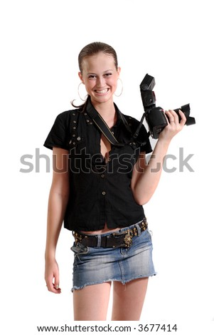 Young beautiful smiling woman holding a photo camera. Isolated over white background
