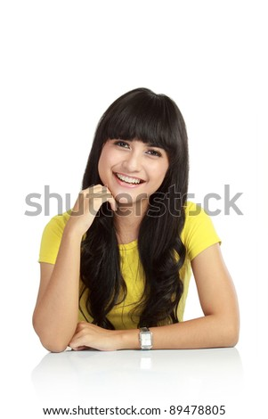 Young beautiful smiling woman standing against white background - stock photo