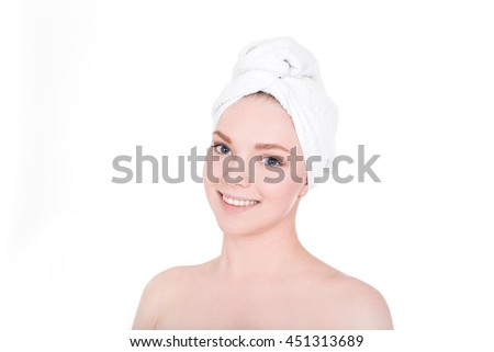 Young beautiful smiling woman with white towel on her hair after bath portrait - stock photo