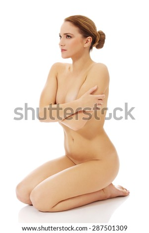 Young beautiful spa woman sitting on the floor. - stock photo