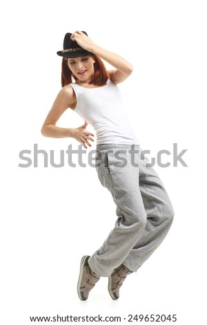 Young beautiful sports woman dancing on a white background. Modern dances.