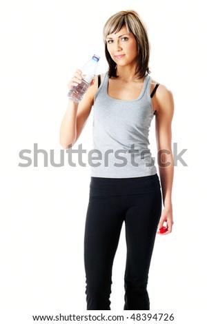Young beautiful sportswoman drinking water. - stock photo