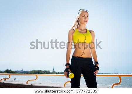 Young, beautiful, sporty and fit girl rollerblading on inline skates - stock photo