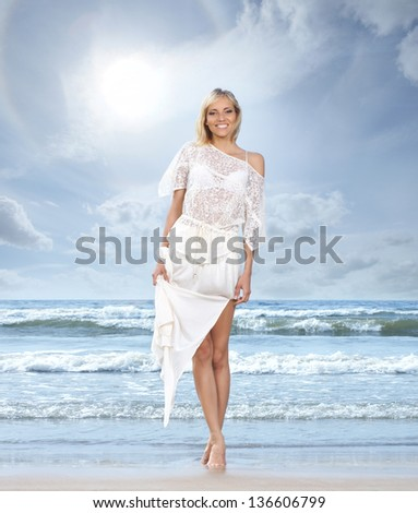 Young, beautiful, sporty and sexy blond woman on the beach - stock photo