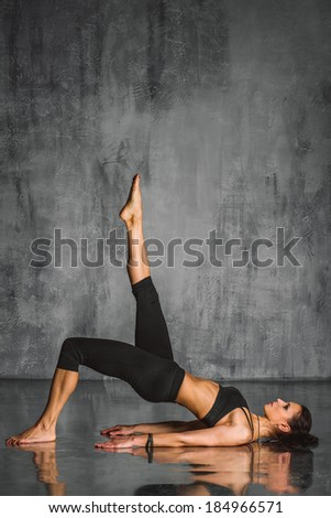 young beautiful sporty woman posing on studio background - stock photo