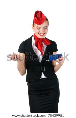 young beautiful stewardess checking ticket - stock photo