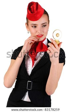 young beautiful stewardess looking at mirror - stock photo