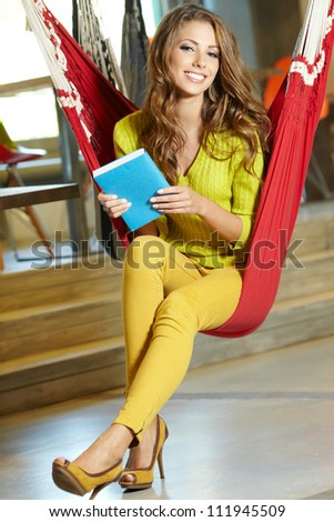 Young beautiful student girl  in hammock - stock photo
