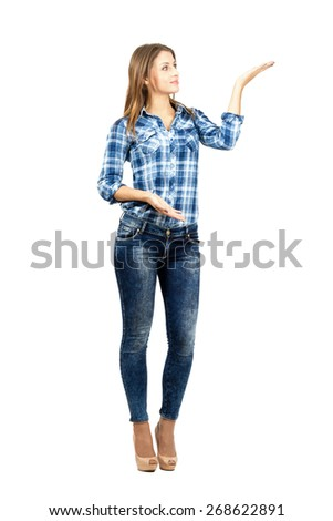 Young beautiful student presenting. Full body length portrait isolated over white background.  - stock photo