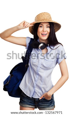 Young beautiful student with a rucksack and headphones on white background - stock photo