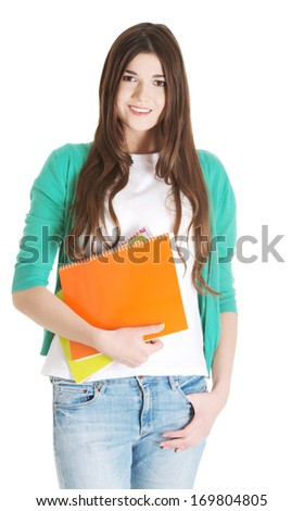 Young beautiful student with files, workbook. Isolated on white. - stock photo