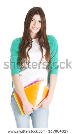 Young beautiful student with files, workbook. Isolated on white.