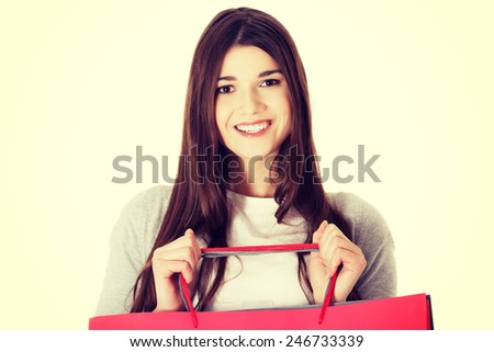 Young beautiful student woman is shopping.  - stock photo